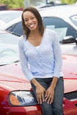 Woman choosing new car — Stok fotoğraf