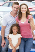 Young family collecting new car — Foto Stock
