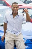 Man picking up new car — Stock Photo