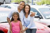 Family on new car lot — Stock Photo