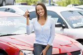 Woman picking new car — Stock Photo