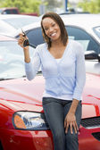 Woman picking up new car — Stock Photo