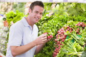 Young man shopping for fresh produce — Stock Photo