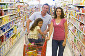 Young family grocery shopping — Stock Photo