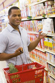 Young man grocery shopping — Stock Photo