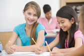 Elementary school pupils in classroom — Stock Photo