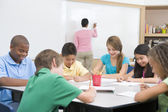 Elementary school clasroom with teacher — Stock Photo