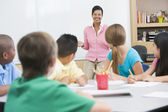 Elementary school classroom with teacher — Stock Photo
