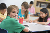 Elementary school pupil at desk — Stock Photo