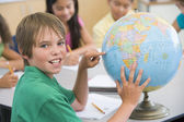 Elementary school pupil with globe — Stock Photo