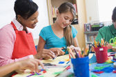 Elementary pupil in art class — Stock Photo