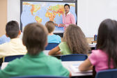Elementary school teacher in geography class — Stock Photo