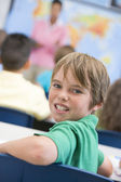 Elementary school pupil in classroom — Stock Photo