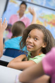Pupil in elementary school classroom — Stock Photo