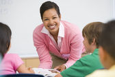Elementary school teacher in class — Stock Photo