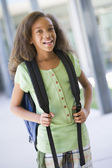 Elementary school pupil outside building — Stock Photo