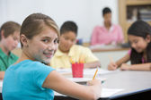 Elementary pupil in school classroom — Stock Photo