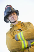 Portrait of a female firefighter — Stock Photo