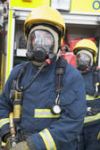 Firefighters in protective workwear — Stock Photo