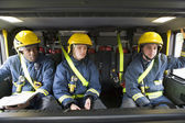 Firefighters on their way to an emergency scene — Stock Photo