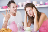 A young couple arguing at the breakfast table — Stock Photo