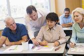Mature students learning art skills — Stock Photo