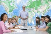 School children and their teacher in a high school class — Stock Photo