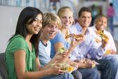Teenagers enjoying lunch together — Stock Photo