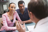 Couple having discussion with doctor in IVF clinic — Stock Photo