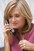 Consultant phoning client with good news — Stock Photo
