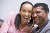 Couple receiving good news over phone — Stock Photo