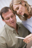 Couple looking at home pregnancy test — Stock Photo