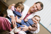 Consultant holding IVF children — Stock Photo