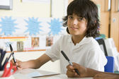 A schoolboy studying in class — Stock Photo