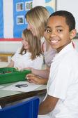 Schoolchildren and their teacher in an art class — Stock Photo