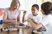 Schoolchildren and their teacher in a science class — Foto Stock