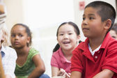 Kindergarten children in classroom — Stock Photo