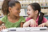 Kindergarten children using computer — Stock Photo