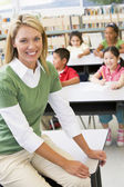 Teacher and students in kindergarten class — Stock Photo