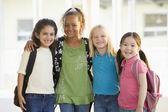 Three kindergarten girls standing together — Stock Photo
