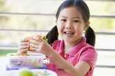 Girl eating lunch at kindergarten — Stock Photo