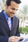 Businessman using PDA — Stock Photo