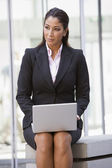 Businesswoman using laptop outside — Stock Photo
