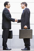 Businessmen meeting outside office — Stock Photo