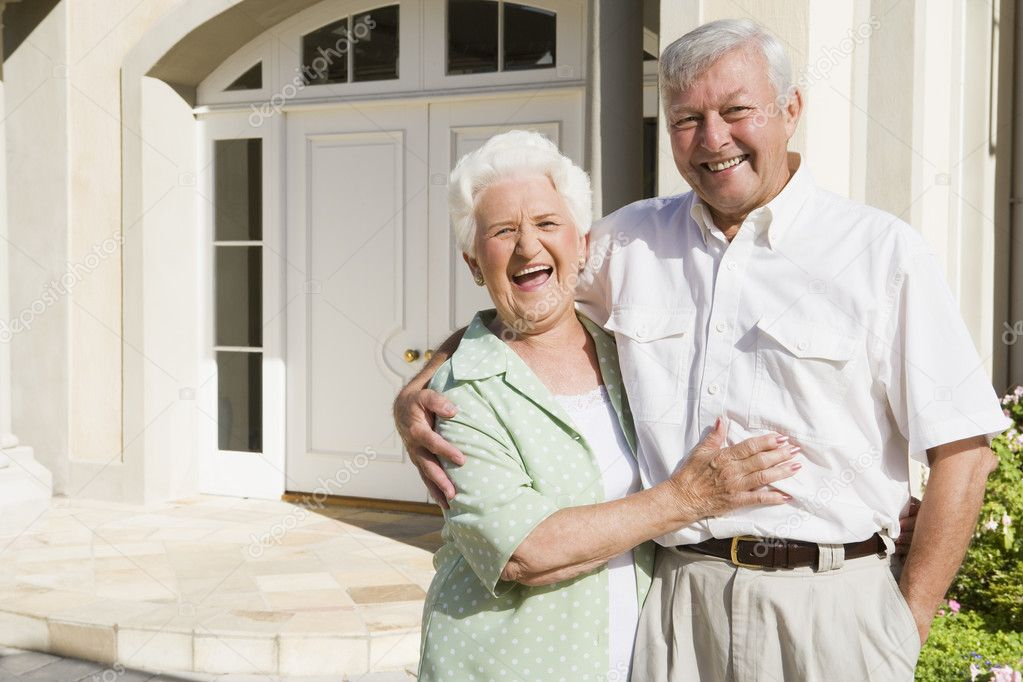 Senior couple embracing outside house  Stock Photo #4752859