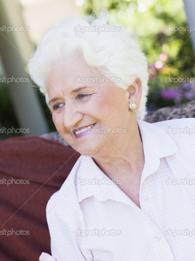 Senior woman sitting outside on garden chair — Stock Photo #4752938