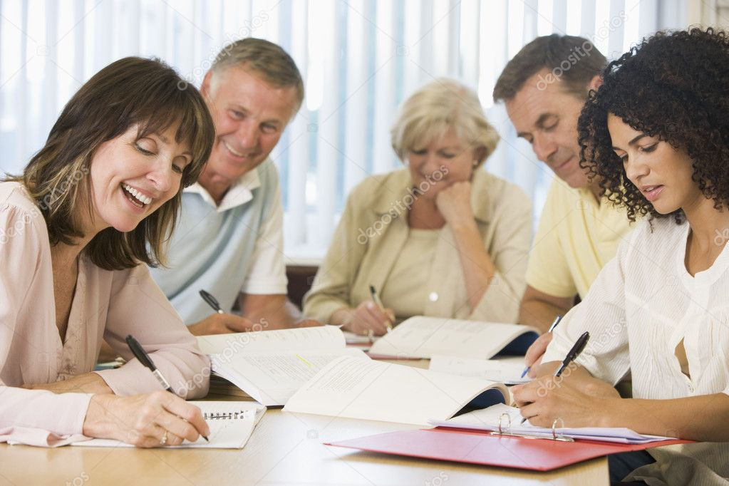 Adult students studying together — Stock Photo #4754321