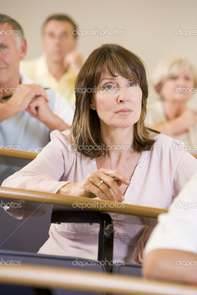 Female adult student listening to a university lecture  Stock Photo #4754342