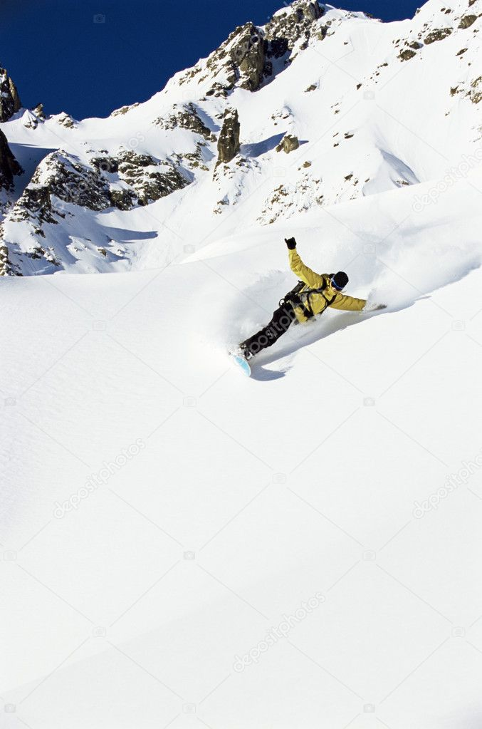 Young woman snowboarding — Stock Photo #4754601