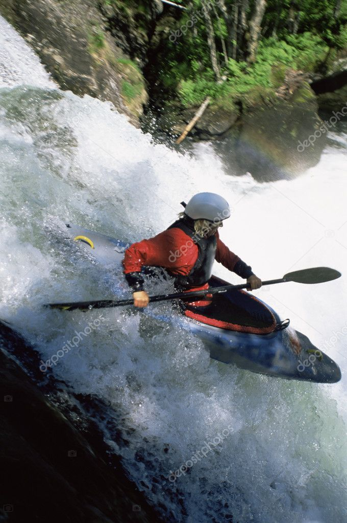Young woman kayaking down waterfall  Stock Photo #4754691